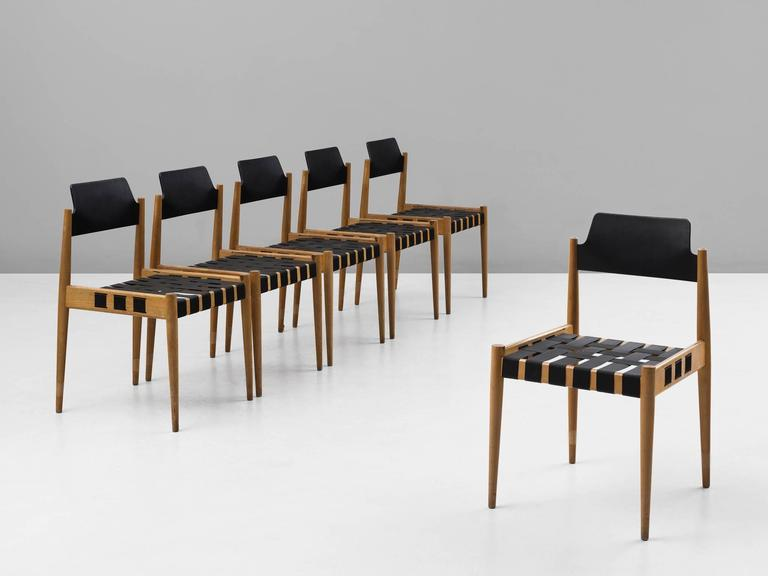 Set of six chairs model SE 120, in beech and webbing, by Egon Eiermann for Wilde + Spieth, Germany, 1960.   Six stackable chairs, designed for and used in the Kaiser Wilhelm Gedächtnis Kirche Berlin 1957-1963. The chairs consist of a basic design