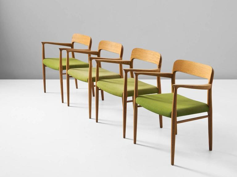 Set of four dining chairs model 56, in oak and fabric, by Niels Otto Møller for J. L. Møller, Denmark, 1954.    This set of chairs shows subtle lines and beautiful curves of the woodwork. In the highly refined connections of the wood you can see the