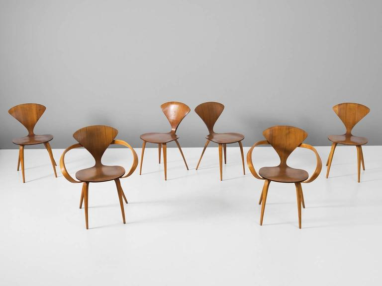 Set of six dining chairs, in walnut and plywood, by Norman Cherner for Plycraft, United States 1957. 