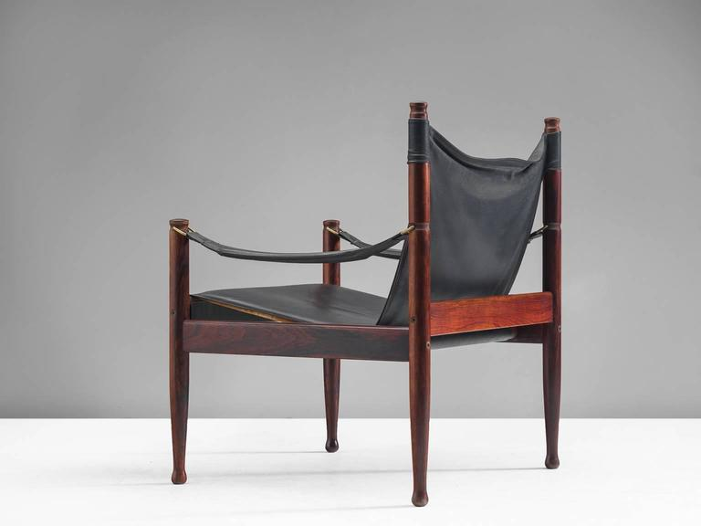 Erik Wørts safari lounge chairs in rosewood and black leather, Denmark, 1950s.