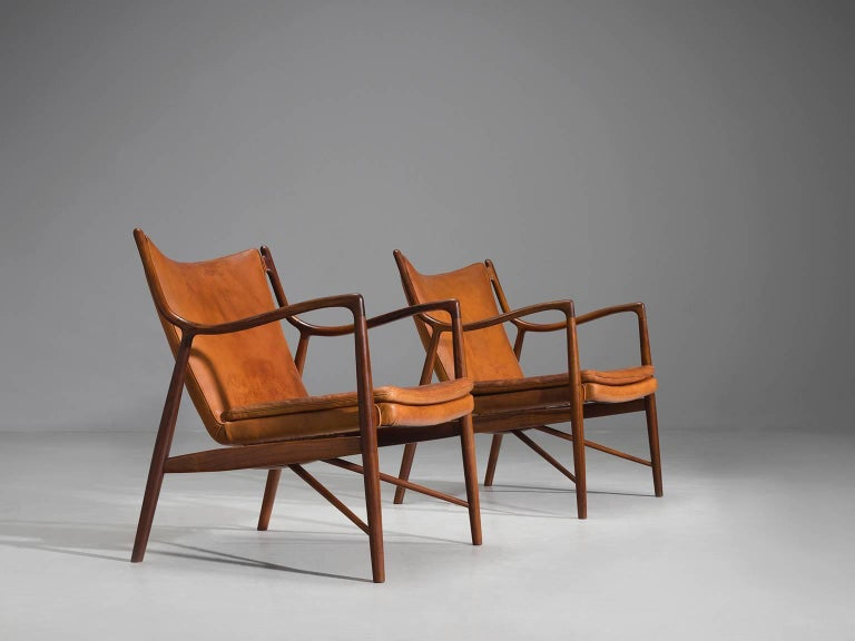 Finn Juhl for Niels Vodder, pair of NV45's, rosewood and cognac leather, Denmark, design 1945, production 1950s.   This set of early NV45 chairs by Finn Juhl and Niels Vodder are executed in cognac leather and solid rosewood. The master woodworker