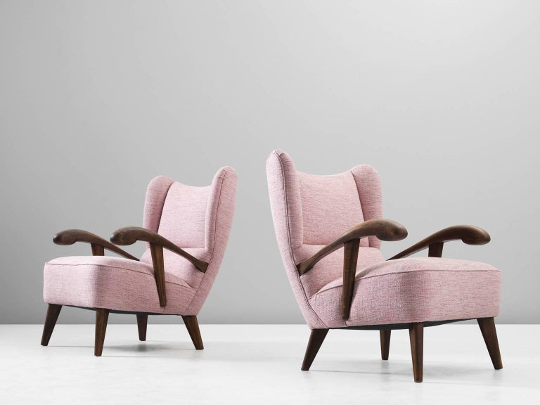 Set of two lounge chairs, in beech and fabric, Czech Republic, 1950s.   Elegant pair of two wingback chairs with solid beech frame. These armchairs show beautiful lines and curves. The grain of the stained wood is nicely visible, especially on the