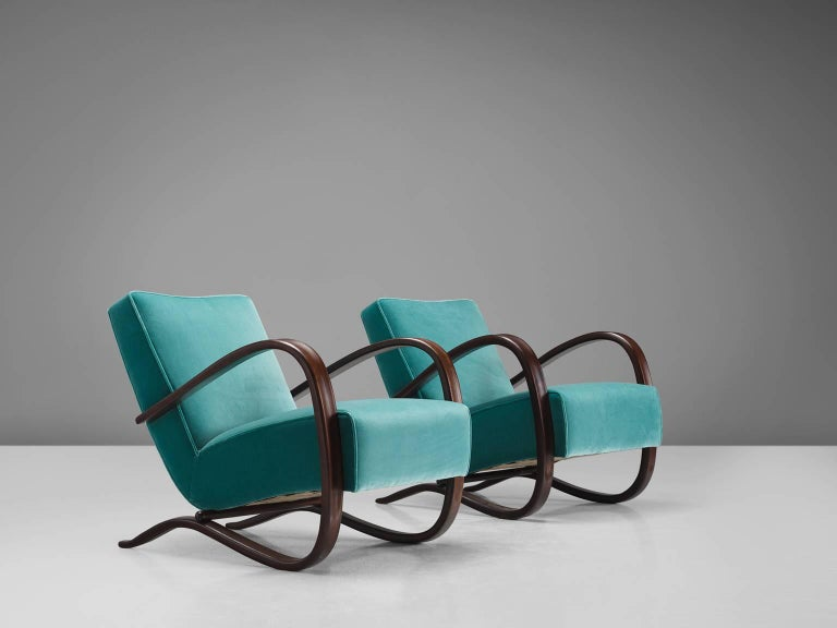 Jindrich Halabala, lounge chairs, green to turquoise velvet and beech, Czech Republic, 1930s.   This extraordinary pair of Halabala chairs are upholstered with turquoise Kvadrat fabric upholstery. The main feature of this chair by Hindrich Halabala
