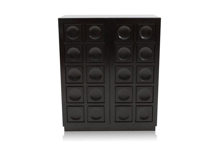 Black Brutalist bar cabinet Two door buffet with graphical door panels. In ebonized oak, dry bar with bottle holder.  Belgium, 1970s.  Measures: L 110 cm, H 134 cm, D 45 cm.