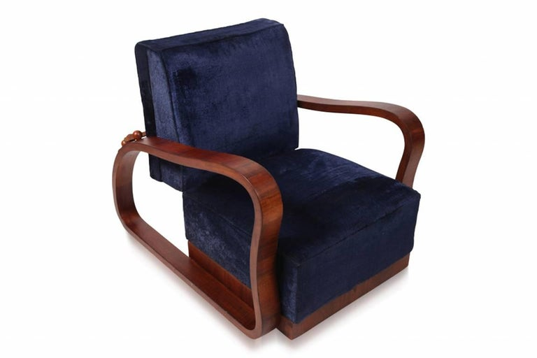 Stunning pair of adjustable Art Deco lounge chairs. The rosewood frames matches perfectly with the original blue velvet upholstery. Manufactured in the Czech Republic, 1930s.
