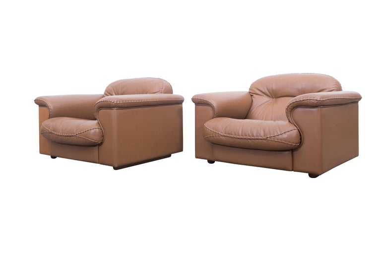 Set of two adjustable DS 101 lounge chairs by De Sede  Adjustable and very comfortable lounge chairs by De Sede, Swiss, 1960s The chairs are upholstered in very high quality leather and finished with interesting thick stitched seams.  Side