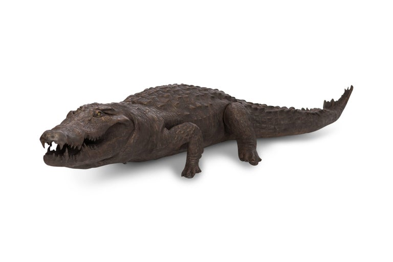 Hollywood regency life-size fiber glass crocodile with bronze patina. Extremely decorative item!  UK - 1980s.  Would fit well in a tropicalism inspired eclectic interior like  from Gabriella crespi