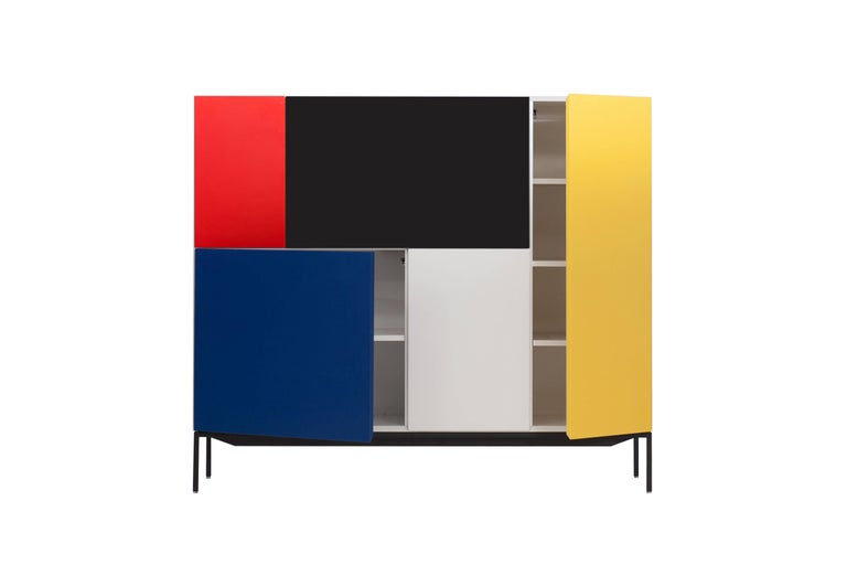 Pastoe special edition cabinet celebrating 100 years of De Stijl (1913-2003)  Mondriaan inspired front panels in typical colors.  Black metal frame  Measures: H 117 cm W 135 cm D 45.5 cm.