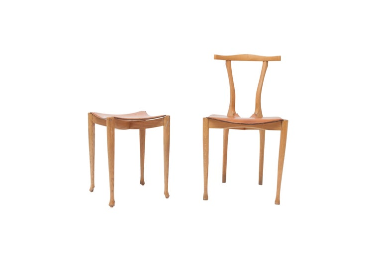 Gaulino chair and ottoman designed by Oscar Tusquets. In tribute to Carlo Mollino and Antonio Gaudí. Oak and cognac leather. This is an original first production set. Spain, 1980s. Measure: Chair H 84 cm x D 49 cm x W 46 cm Ottoman H 47 cm x D