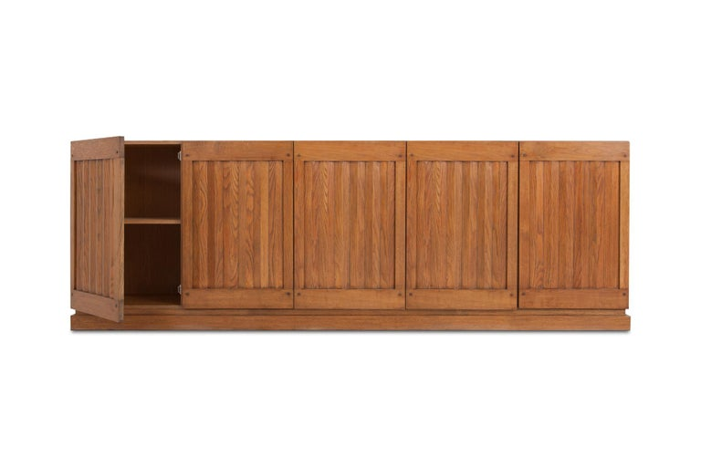Minimalist oak sideboard with geometrical door panelling. Would fit well in a Brutalist, Minimalist interior as in a more Hollywood Regency Kelly Wearstler inspired interior. Belgium, 1970s.
