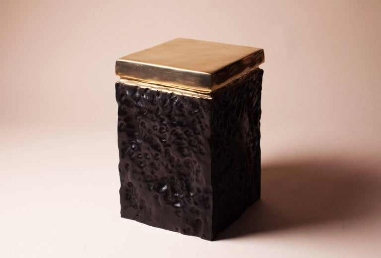Hollywood Regency hand casted bronze stool A polished smooth surface top on black patinated bronze base.  The black irregular surface gives it a luxurious but cosy feel. The polished top makes it pretty and convenient in use.  Extremely