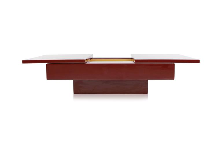 Jean Claude Mahey sliding bar coffee table. France, 1980s. Burgundy red lacquer, brass inside. Hollywood Regency glam.  Closed: L 130 cm W 80 cm H 40 cm Opened: L 180 cm.