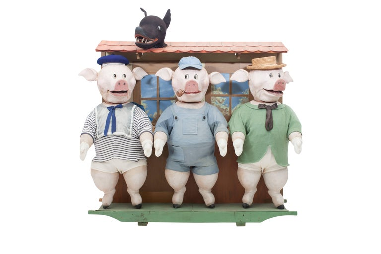 The three little pigs and the big bad wolf's movable puppetry piece.  A most rare item, depicting the famous fable by Joseph Jacobs. A true story teller with a back system designed to control the pigs and wolf separately.  Italy, 1930s.  Measures: H