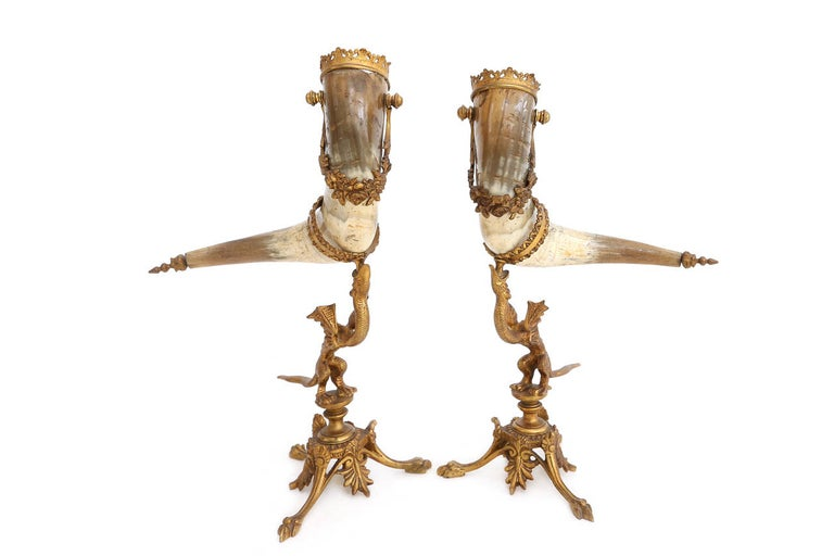 Beautiful pair of Horns  Mounted on brass dragons  Measures: H 40 cm x W 30 cm.