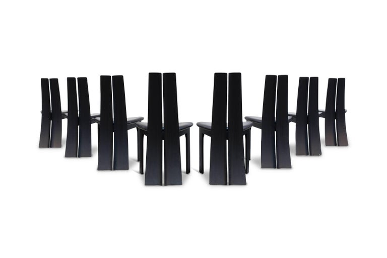 Minimalist set of eight dining chairs by Van Den Berghe - Pauvers.  Black leather in great condition - beautiful sculpted chairs with an high arched back  Belgium, 1970s.
