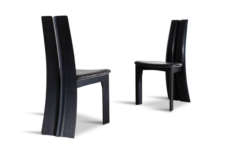 Mid-Century Modern Mid-century modern sculptural ebonized dining chairs, set of eight For Sale