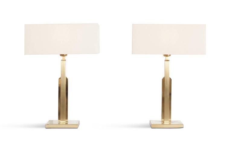 Brass glamorous Hollywood regency style lamps skyscraper design with white linnen rectangular shades. France - 1970's