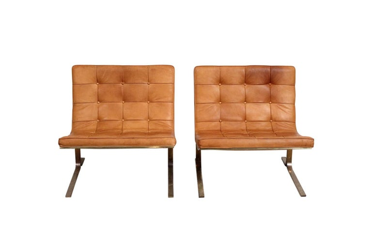 Tufted brown leather CH28 lounge chair with cantilevered bronze finish bases designed by Nicos Zographos. Designed by Zographos while working at Skidmore, Owens and Merrill, circa 1960. Very minimal and chic design.
