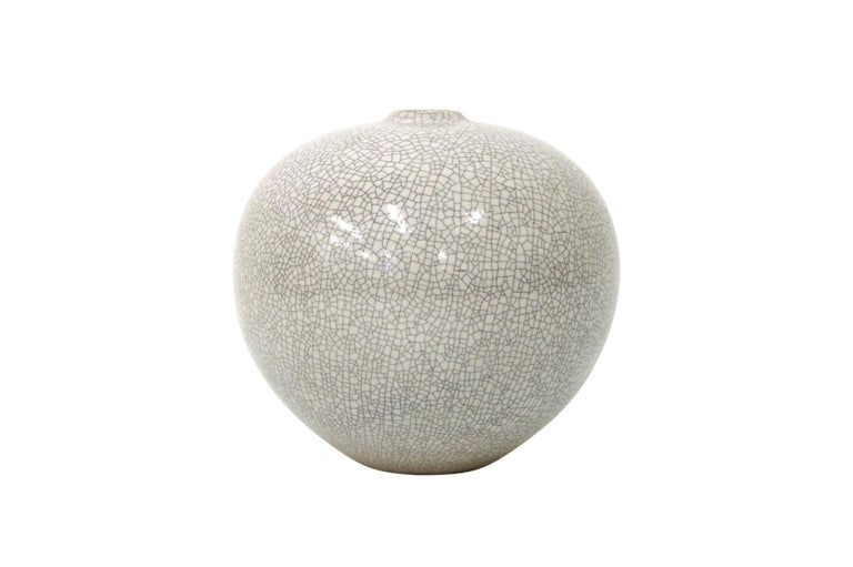 Spherical bone white vase by American ceramicist Cliff Lee. Lee is well known for recreating long lost Chinese glazes. This vase from the 1990s employs a refined and stunning crackle glaze.