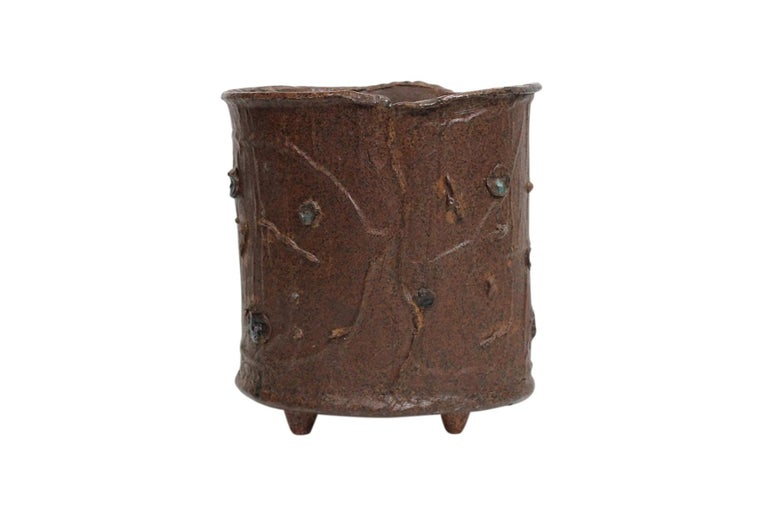 Large footed ceramic vessel or wastebasket by noted Massachusetts potter William Wyman. Elaborate torn, pinched, and altered surface throughout. Signed underneath.