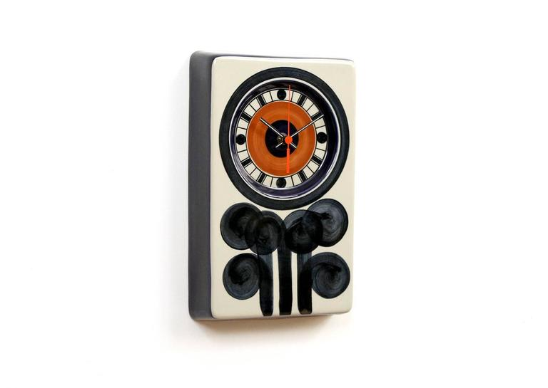 Graphic ceramic clock designed by Marianne Westman for the Swedish company Rorstrand. Westman designed a variety of colorful objects for Rorstrand over 20 years with the company. Clock is running and keeping time. Signed with stamp to the reverse