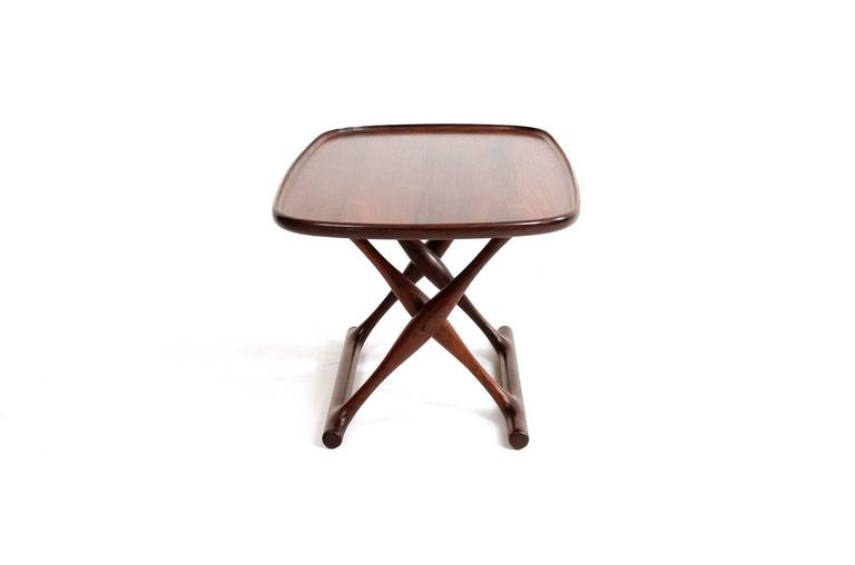 Guldhoj rosewood tray table and leather folding stool designed by Poul Hundevad. Finely grained rosewood table top and attractive patina to the brown leather of the folding stool.  Signed with the manufacturers decal to underneath of the tray top.