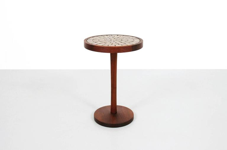 Circular walnut and ceramic side or drink table by Gordon and Jane Martz for Marshall Studios. Table features a solid walnut base and graphic mosaic tile top.