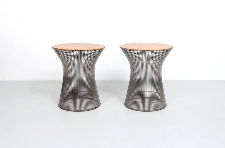 Iconic pair of side tables by Warren Platner for Knoll. These examples in chrome wire with oak tops.