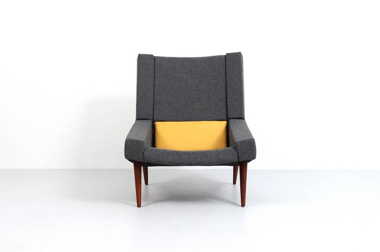 Rare pair of upholstered high back lounge chairs with teak legs designed by Illum Wikkelsø for Soren Willadsen. Incredibly graphic and geometric form. Dark grey fabric is Tonica-182 by Kvadrat.