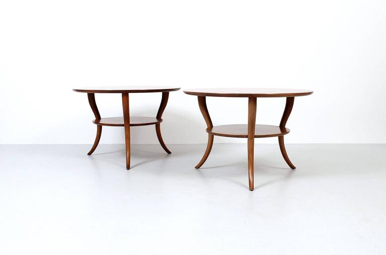 Pair of saber leg side tables designed by T.H. Robsjohn-Gibbings for Widdicomb.
