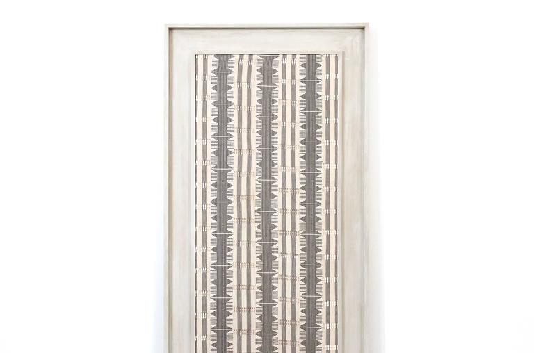 Impressive large scale Modernist textile in custom frame. This woven piece is reminiscent of work by Jack Lenor Larsen and British fiber artist Peter Collingwood.