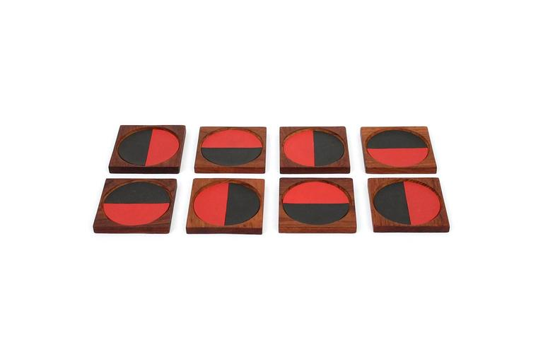 Set of eight coasters in teak with two-tone recessed drink surfaces by Danish firm Laurids Lonborg. Useful objects with a strong graphic design. The perfect addition to a stylish bar setup.
