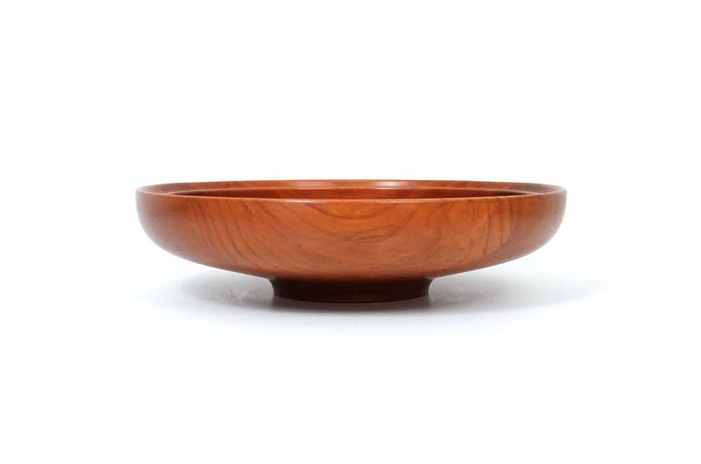 Large-scaled teak serving bowl designed by Henning Koppel for the Danish company Georg Jensen. Beautifully figured and grained solid teak. Branded to underside along with original retailer's label.