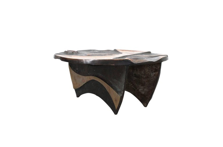 Custom designed bronze coffee table by well-known North Carolina sculptor Wayne Trapp. Abstractly carved top is reminiscent of Isamu Noguchi's designs for playgrounds. Table can be used with or without glass top.