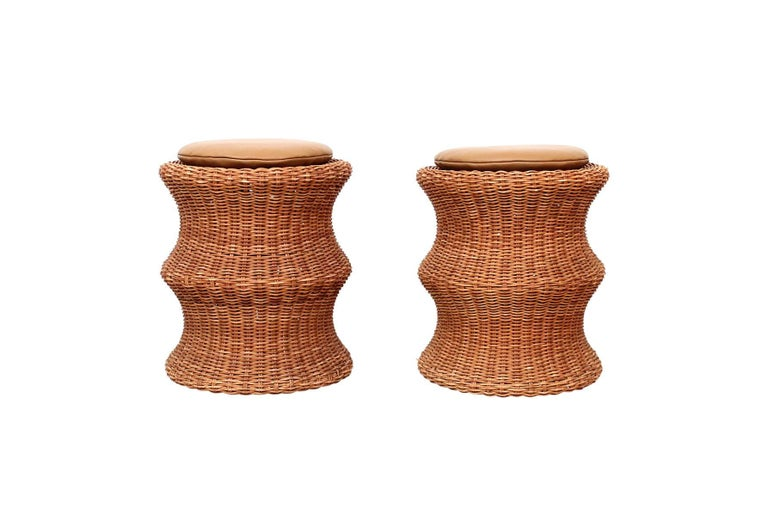 "Early matched pair of ""Juttu"" stools by Eero Aarnio. Can be used as footstools or side tables. Original wicker has a pleasant golden patina. Made by Sokeva in Finland, circa 1960s. One example retains original decal ""DESIGN EERO"