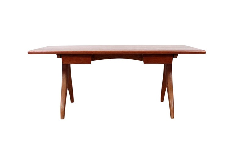 Rare studio furniture desk in fruitwood by Jere Osgood. Desk features a solid top with two slide out drawers and sculptural base. Signed and dated to 1976. Osgood's work can be seen in renowned collections including the Museum of Fine Arts, Boston,