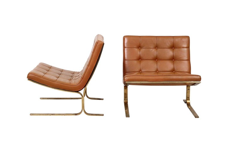 Mid-Century Modern Pair of Leather Lounge Chairs by Nicos Zographos For Sale