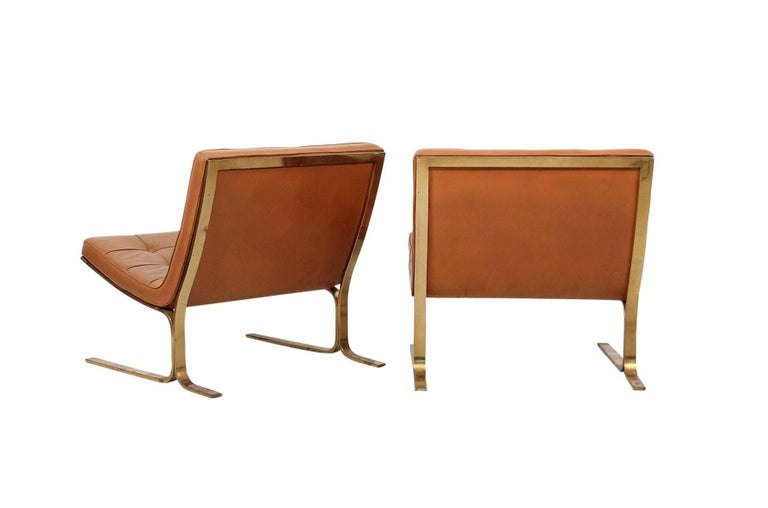American Pair of Leather Lounge Chairs by Nicos Zographos For Sale