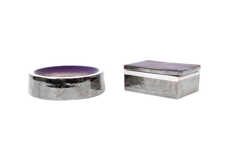 Italian pottery catch-all and covered box by Bitossi for Raymor. Subtle colorful glazing on top surfaces with chrome mirror and white glazes on the sides and interior. Signed with partial labels and impressed marks. Dimensions below are for the