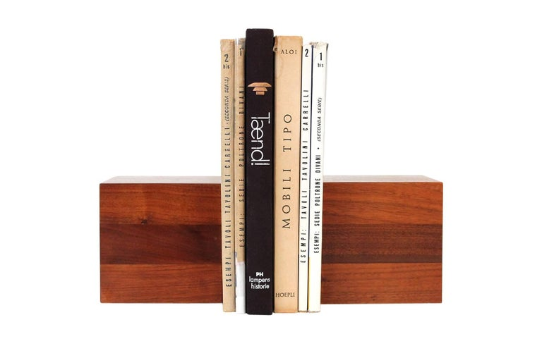 Sculptural solid walnut bookends designed by Jane and Gordon Martz for Marshall Studios. Bookends have good scale and will accommodate a range of book display options.