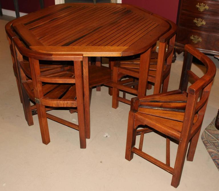 A Solid Hexagonal Teak Wood Garden Table With Six Custom Fitted Chairs Made  By Hughes Bolckow