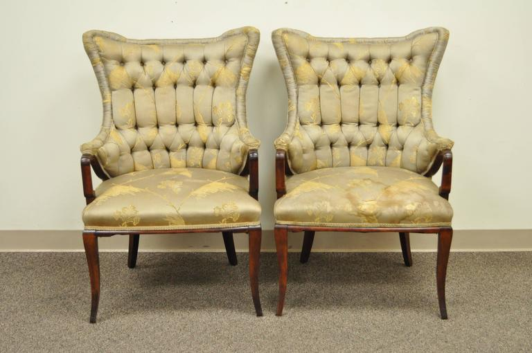 Quality pair of 1940s mahogany fireside armchairs attributed to Grosfeld House. The pair has a very unique Chinese Chippendale style with shaped wingbacks and tapered legs.