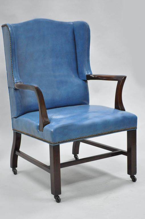 Mid 20th century blue leather office desk chair on casters for Mid 20th century furniture