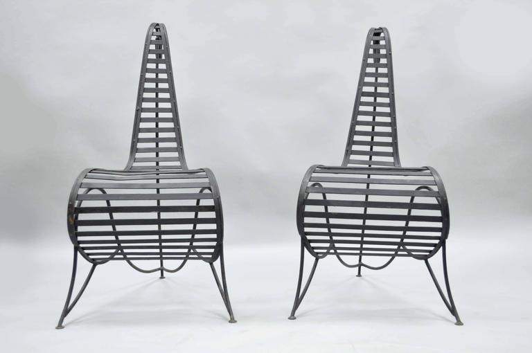 Mid-Century Modern Pair of Sculptural Steel and Iron Spine Lounge Chairs after André Dubreuil For Sale