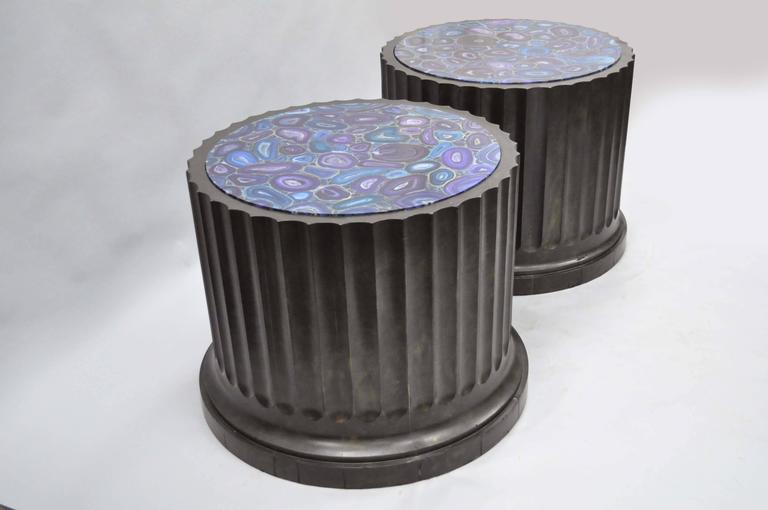 Impressive and large pair of Mid-Late 20th century custom-made fluted column pedestal stands with faux specimen painted tops. This substantial pair of architectural pedestal tables is made of solid wood with black distress painted column bodies and