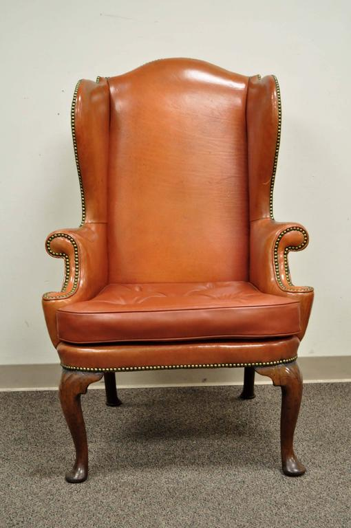 Antique 19th Century Burnt Orange Distressed Leather English Wingback Chair.  Item Features A Dramatic Solid