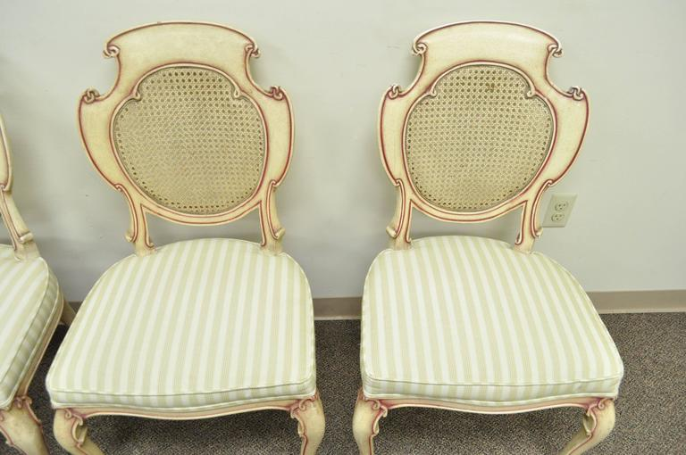 Four Scroll Carved Italian Hollywood Regency Cream Pink Cane Back Dining Chairs For Sale 1