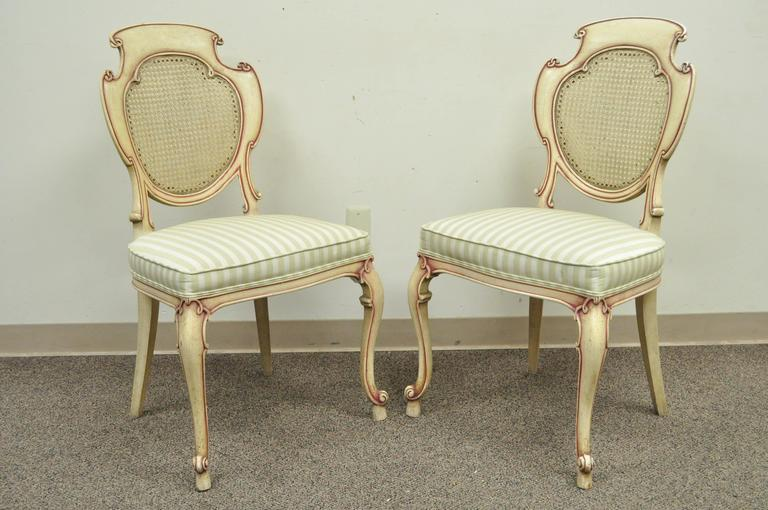 Four Scroll Carved Italian Hollywood Regency Cream Pink Cane Back Dining Chairs In Good Condition For Sale In Philadelphia, PA