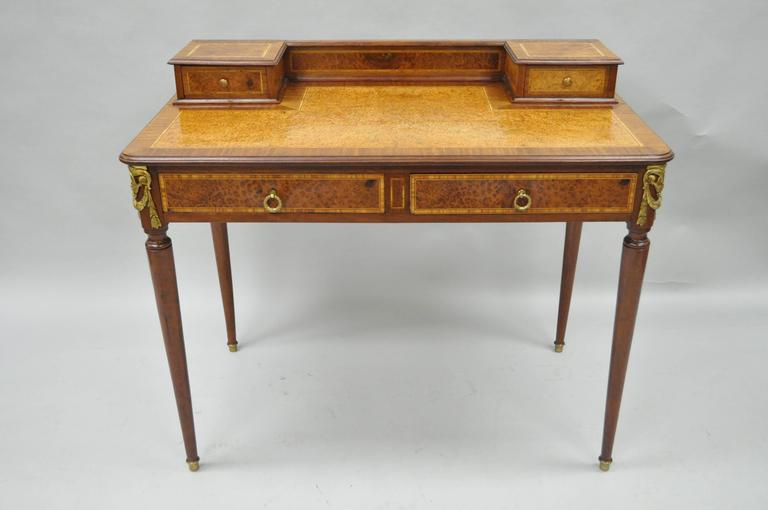 Early 20th century petite French Louis XVI style ladies writing desk. Item  features a mahogany - French Louis XVI Style Inlaid And Bronze Ormolu Ladies Writing Desk