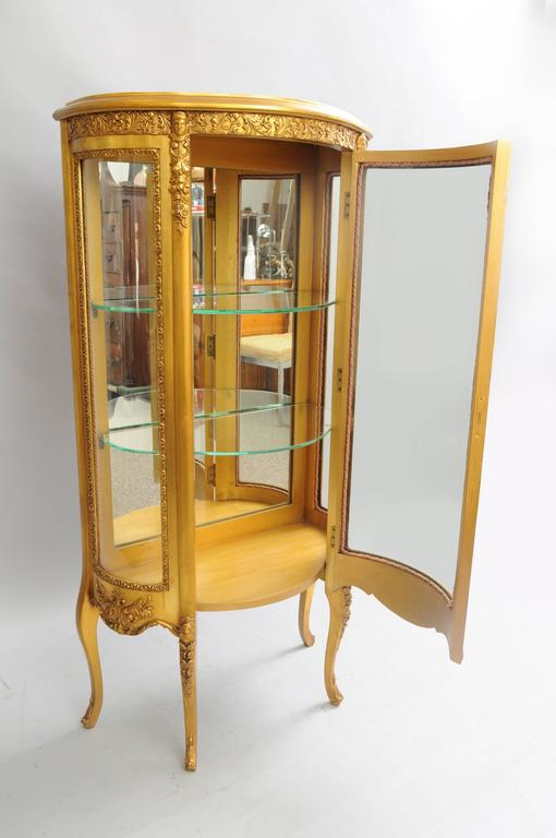 Small antique French Louis XV style gold giltwood curved glass figural  display case. Item features - Small French Louis XV Style Gold Giltwood Curved Glass Vitrine Curio